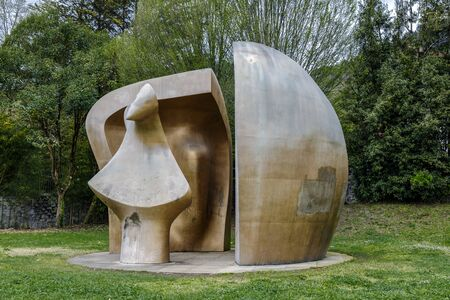 Guernica, Spain - April 09, 2018:  Sculpture by Henry Moore Large Figure in a shelter. Brought to Gernika in 1991. This sculpture is part of the War Helmets collection that the artist started duri 報道画像