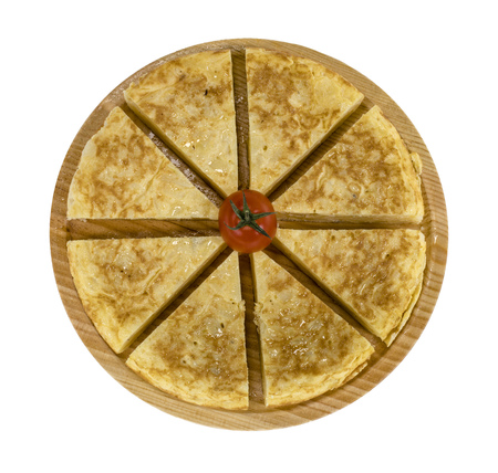 A triangle of potato Spanish omelette on a plate isolated background in white color Banco de Imagens - 104454452