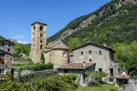 View of the bell tower and the apse of the Romanesque church of Beget, Spain