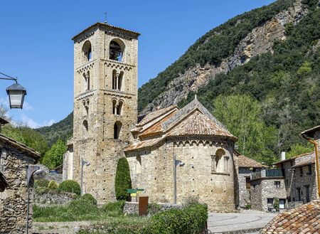 View of the bell tower and the apse of the Romanesque church of Beget Stok Fotoğraf - 137893069