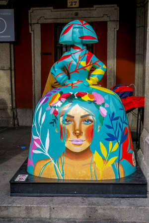 "Madrid, Spain - November 10, 2019: Spanish Menina in the city center. The artist Antonio Azzato creates an impressive exhibition recalling the famous ""meninas"" from Velazquez."