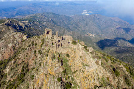 The ruins of the castle de Verdera located at the top of a steep rocky spur, Spain, Catalonia, Alt Emporda, Girona Stock Photo
