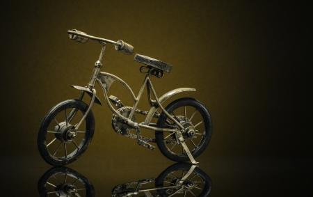 Model of bronze vintage bike on a sepiabrown background