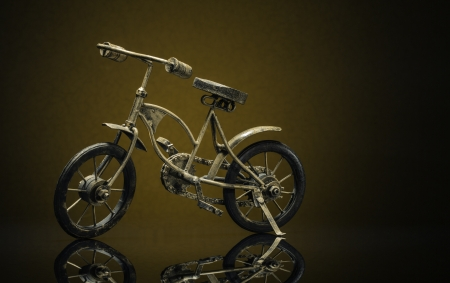 Model of bronze vintage bike on a sepiabrown background