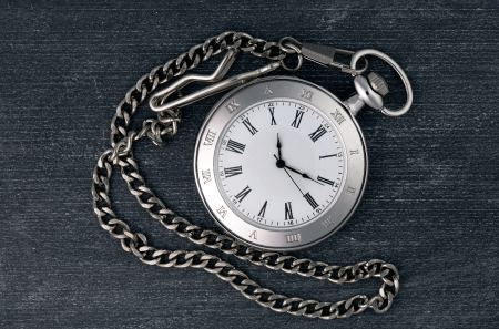 Shiny silver chain watch on a black chalkboard background Stock Photo - 18262003
