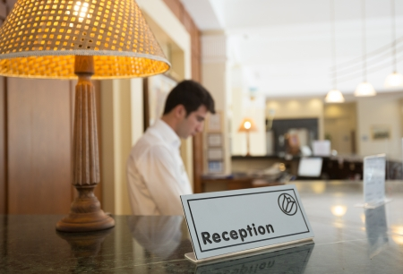 Hotel reception desk with a table and receptionists on a background Stock Photo - 18310842