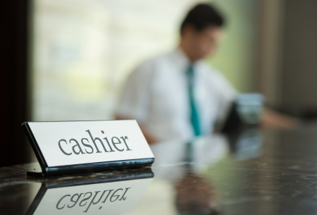 Hotel reception desk with cashier table and receptionists on a background Stock Photo - 18310706