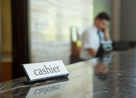Hotel reception desk with a cashier table and receptionist on a background Stock Photo
