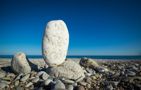 Stack of sea stones (pebbles) balancing on a sea and sky background Stock Photo - 18311556