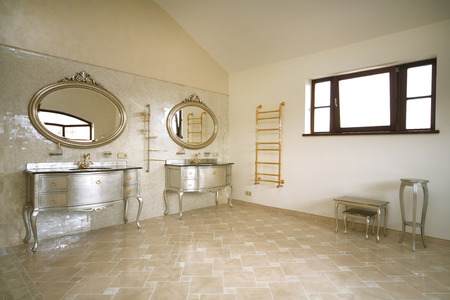 Vintage beige color bathroom with a golden sanitary engineering