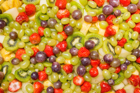 Bright fruit salad  as a background