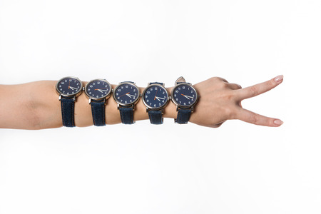 Human hand showing a victory sign and  wearing five identical watches  Stock Photo