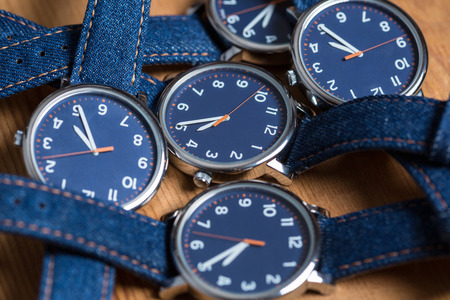 Set of watches with a blue dial and blue jeans strap Stock Photo