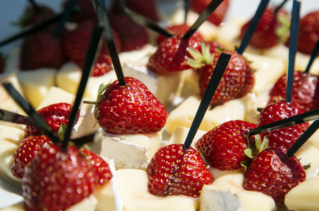 penicillium: Camembert served with strawberries as an appetizer Stock Photo