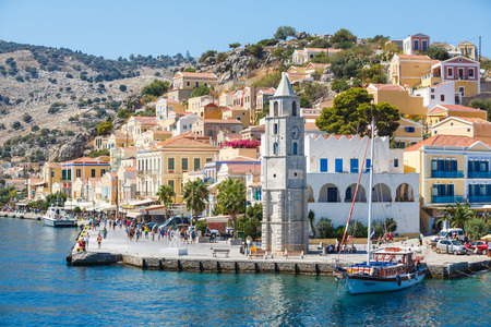 tripping: SYMI, GREECE - September 6,2015: Looking down onto boats moored in Yialos harbour on Symi island, Greece. Symi is easy and most popular destination for day tripping from Rhodes island.