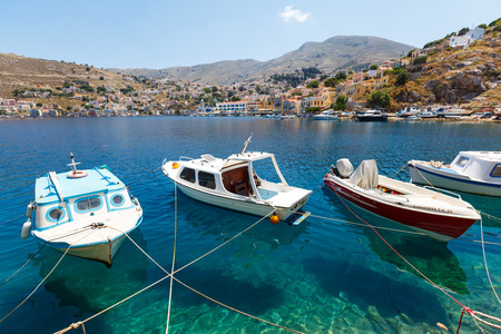 tripping: SYMI, GREECE - JUNE 12,2015: Fishing boats moored in Yialos harbour on June 12, 2015 on Symi island, Greece. Symi is easy and most popular destination for day tripping from Rhodes island.