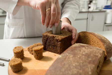 porosity: Bread porosity  tests in a laboratory on a bread manufacture Stock Photo