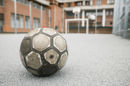 leather ball: Old worn leather ball  on a playground