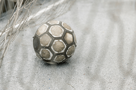 leather ball: Old worn leather ball  in a goal