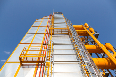 Metal grain drying construction as a part of elevator in agricultural  zone Stock Photo