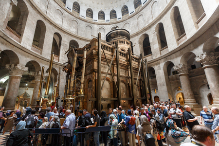 JERUSALEM, ISRAEL - April 06, 2016: Pilgrims and tourists are waiting  to enter Aedicule in Church of the Holy Sepulchre, the world greatest Christian shrine in Jerusalem, Israel