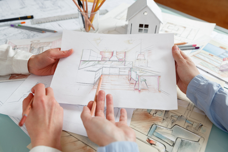 Interior Designers Working On Color Hand Drawings Of A Kitchen Interior At  Work Place. Photo