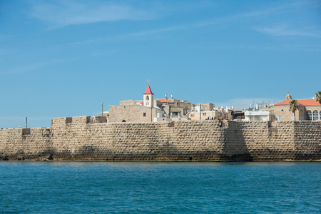 ACRE (AKKO), ISRAEL - APRIL 3, 2016: Seaview of the city and its wall of Akko (Acre), Israel