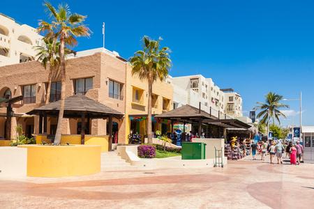 CABO SAN LUCAS, MEXICO -MARCH 20, 2012 : View on marina promenade in Cabo San Lucas marina, popular touristic destination on Baja California, Mexico. Editorial