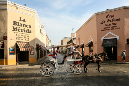 MERIDA, MEXICO - march 11, 2012: Horse carriages on a morning city street in Merida, Yucatan, Mexico