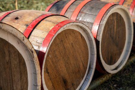 Old wine oak barrels drying in the sun.Winemaking industry concept Фото со стока