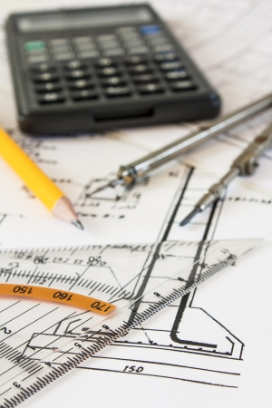 tools and mechanisms detail on the background of engineer drawings photo