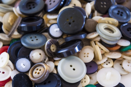 Many different sized colored and shaped buttons photo