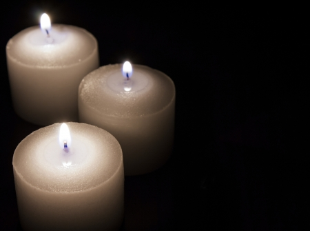 burning paper: candles on dark background Stock Photo