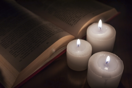 open books and candles on wood table Stock Photo - 14544989