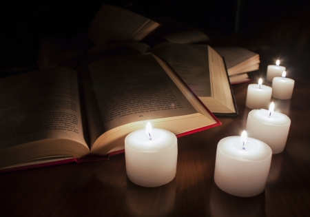 open books and candles on wood table Stock Photo - 14545010