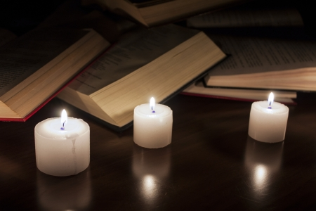 open books and candles on wood table Stock Photo - 14545333