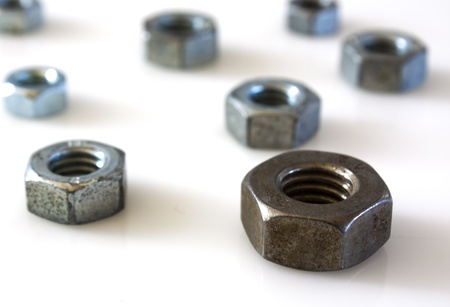 Nut and bolt over white photo