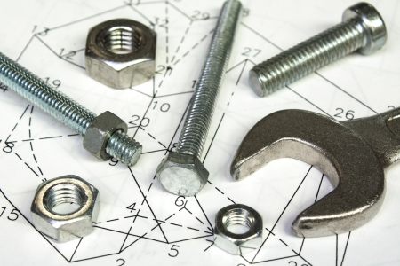 engineering tools: spanner and nuts  on  technical drawing Stock Photo