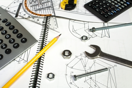 structural engineers: calculator and measuring equipment with nuts on technical drawing