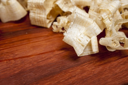wood shavings: wooden shaving on pine wood background