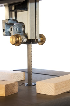 carpenter's sawdust: band saw machine and planks,