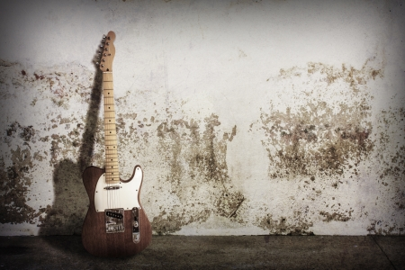 old poster: electric guitar on grunge scene