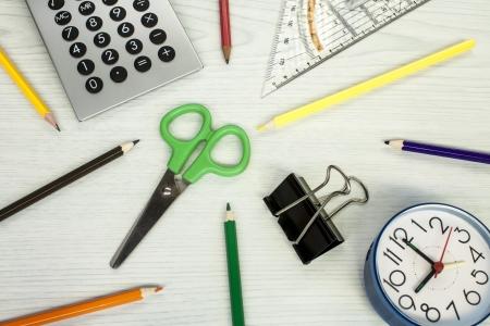school composition, clock, pencils, calculator, measure equipment, and scissors photo