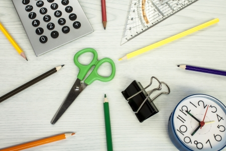 school composition, clock, pencils, calculator, measure equipment, and scissors photo