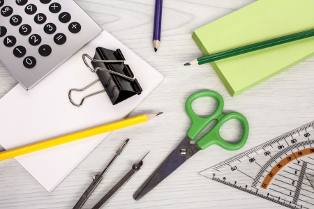 office composition, calculator, pencils, scissors, measure equipment and notepads photo