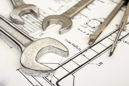 engineering drawing: wrench and compasses  on  technical drawing Stock Photo