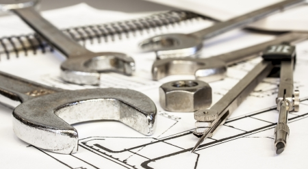 structural engineers: wrench compasses and nuts  on  technical drawing Stock Photo