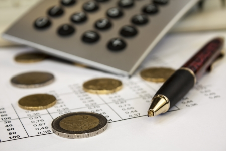 Money, pen and calculator,accounting Stock Photo - 14913415