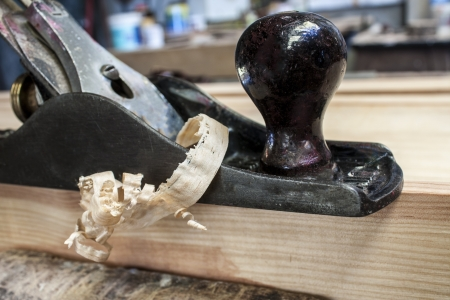 wood plane with construction background photo