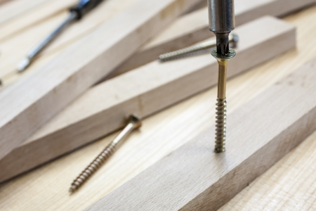 Screws and screw-driver on construction background Stock Photo - 14915887
